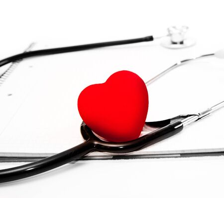wellness background: stethoscope and a red heart over a white background Stock Photo