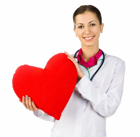 Doctor taking care of red heart symbol  on white background photo