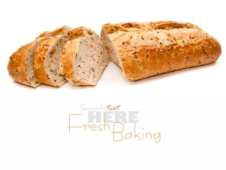 newly baked: Fresh-baked  loaf on a white background