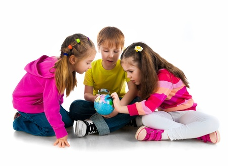 Kids with a globe of the world over white background photo