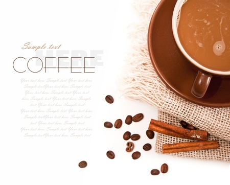 Ceramic cup of coffee with cinnamon on white photo