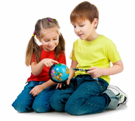human geography: Kids with a globe of the world over white background