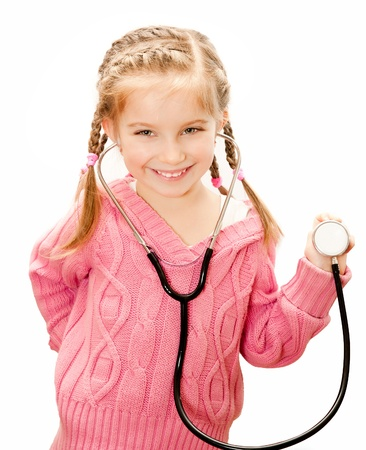 school nurse: little girl with stethoscope in hand.  Isolated over white background.