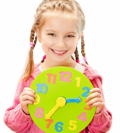 little pretty girl with clock Stock Photo