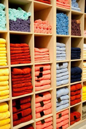 Big shelf with a colorful towels photo