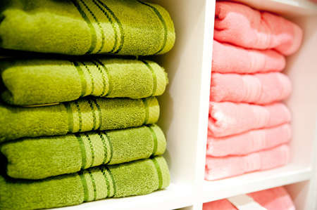Big shelf with a colorful towels Stock Photo - 12479657