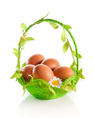 eggs on a green basket  white background Stock Photo - 12970503