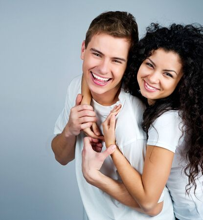 Smiling couple isolated on a white background Stock Photo - 12970515