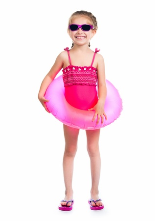 pink bikini: studio shot of little girl in swimsuits
