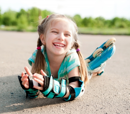 Little girl in roller skates at a park Stock Photo - 13623264