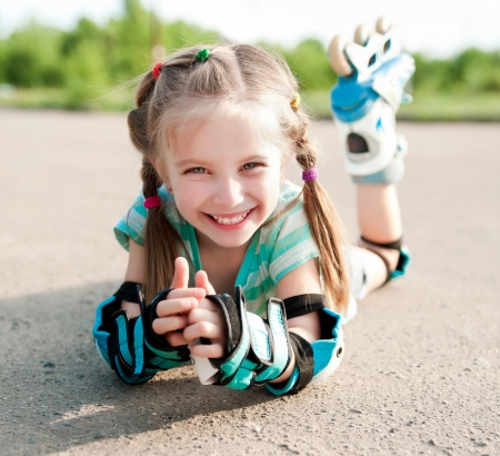 rollerskater: Little girl in roller skates at a park
