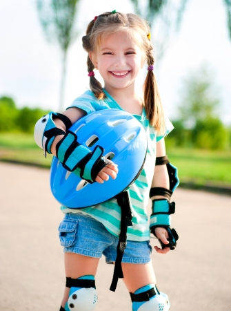 rollerskating: Little girl in roller skates at a park