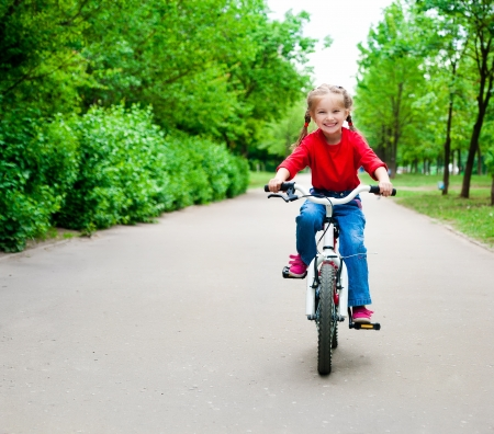 little girl with her bicycle photo