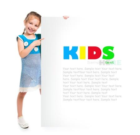 cute child behind a white board