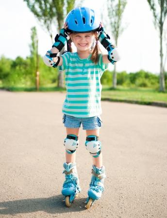 rollerblade: Little girl in roller skates at a park