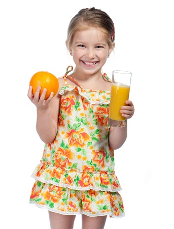 Cute little girl  with the orange juice photo