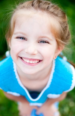 smily face: Cute little girl  on the meadow in summer day