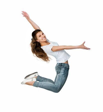 gente saltando: Hermosa niña de salto aislado sobre fondo blanco