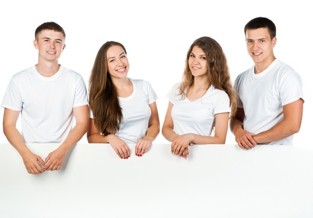 Group of young people looking out white board Stock Photo - 14337306