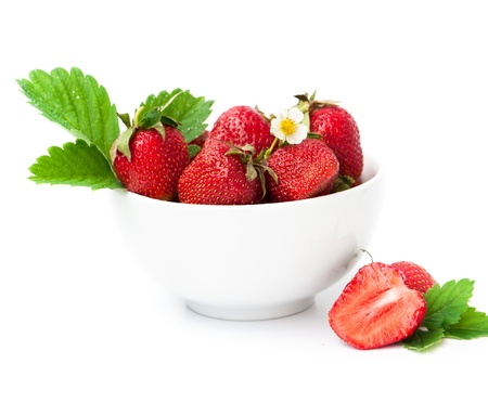 strawberry berry with green leaf and flower isolated on white background photo