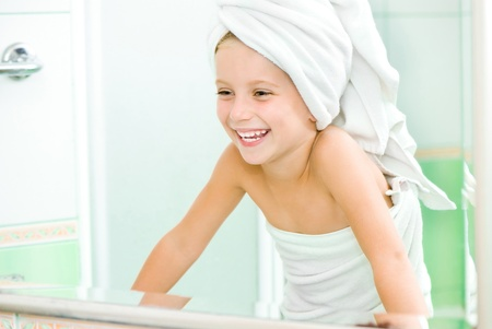 Cute little girl look in the mirror photo