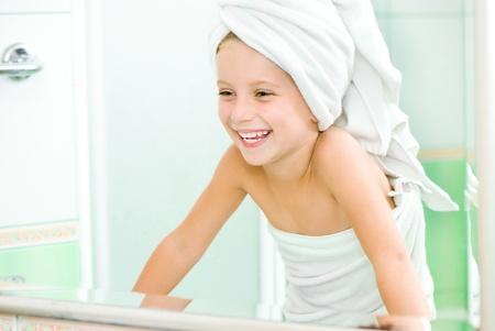 little girl bath: Cute little girl look in the mirror