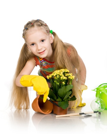 little girl with a flower on a white background photo