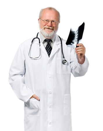 Portrait of senior friendly orthopaedic holding x-ray  Isolated over white background photo