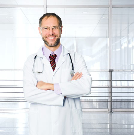 medical doctor with stethoscope over clinic background photo