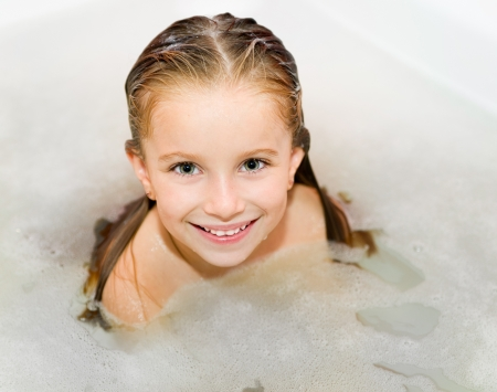 Cute small girl is taking a bath Stock Photo - 16036201