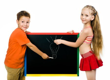 stodio: beautiful boy and girl with a board  stodio shot