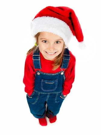 santa cap: Cute little girl in the santa claus hat