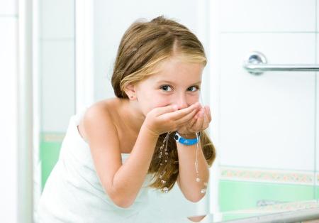 Cute little girl washing in bath
