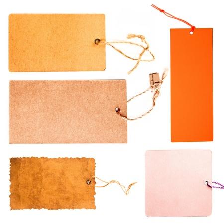 etiquetas de ropa: Conjunto de etiquetas de precio espacios en blanco sobre fondo blanco Foto de archivo
