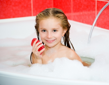 bathwater: Little girl in the bath with a soap