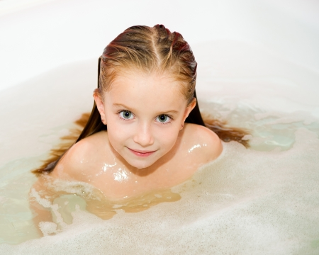 Cute small girl in the bath photo