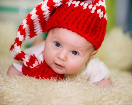 baby girl in a red hat photo
