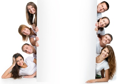 Group of pretty young people looking out white board Stock Photo - 16988388