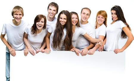 젊은 사람들의 그룹은 화이트 보드를 찾고 스톡 콘텐츠