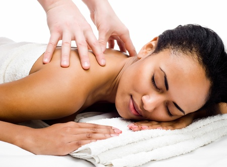 african american nude: perfect young women with closed eyes receiving massage in a spa center Stock Photo