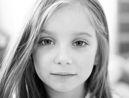 girl face close up: black-and-white portrait of a cute liitle girl Stock Photo
