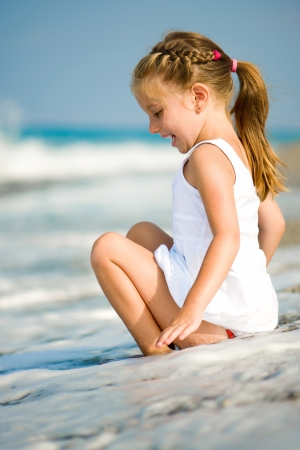 little girl beach: sitting little girl on tropical beach vacation