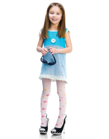 well dressed girl: Pretty little girl in big shoes on a white background Stock Photo