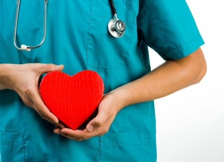 doctor holding a heart symbol on white background Stock Photo - 17412163