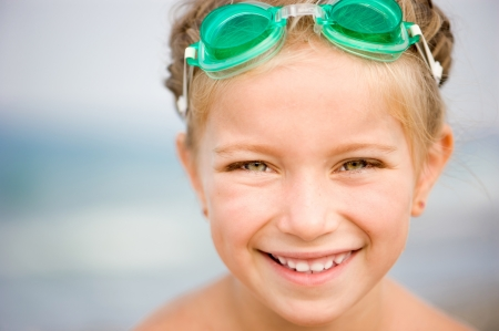 Little girl in swimming pool close-up  Summer outdoor  photo