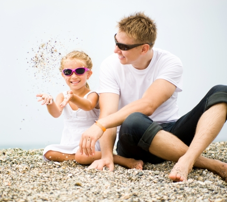 father and his little daughter play on the beach Stock Photo - 17412168