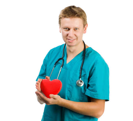 Male doctor with a heart in his hands on a white background photo