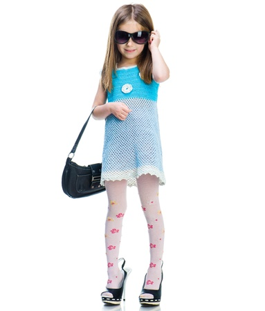 well dressed: Little girl in big shoes  Isolated on white background
