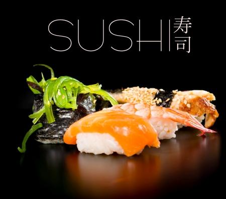 sake: Sushi set over black background Stock Photo