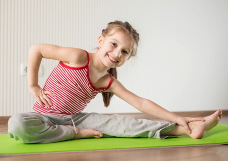 physical: smiling girl with the fitness ball at home